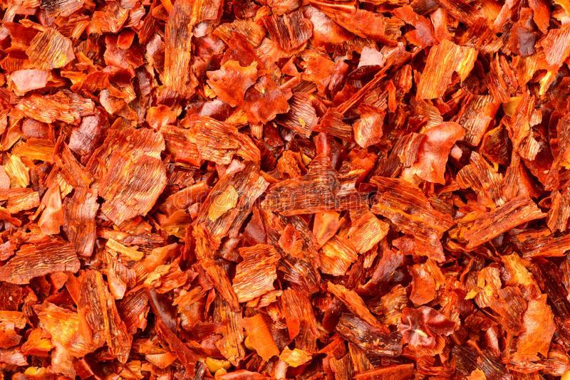 Food background of dried red pepper flakes, top view royalty free stock photo
