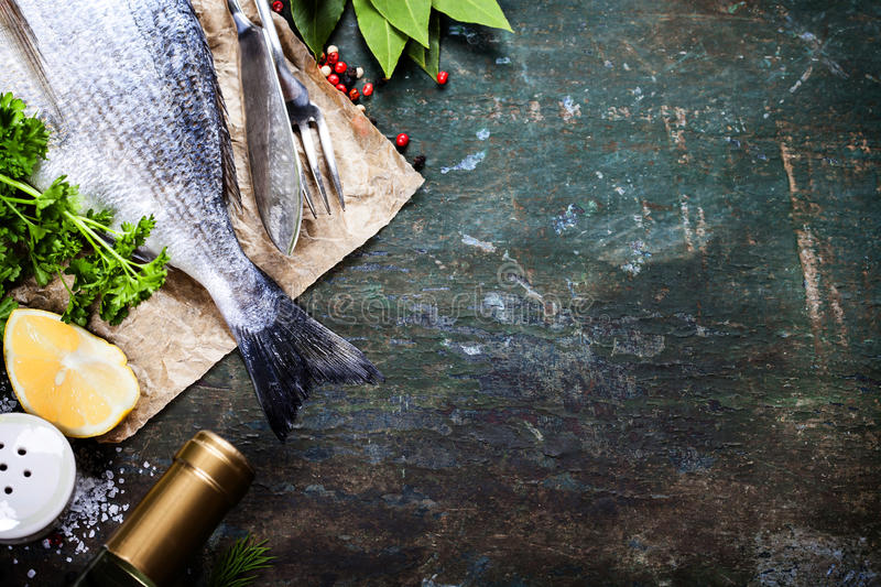 Food background with Fish and Wine. Lots of copy space stock image