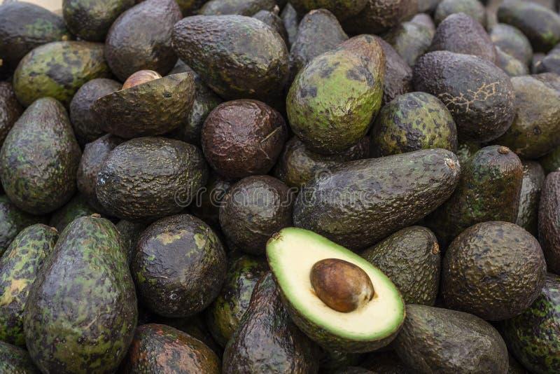 Food background of fresh ripe avocados on spanish marketplace.  royalty free stock image