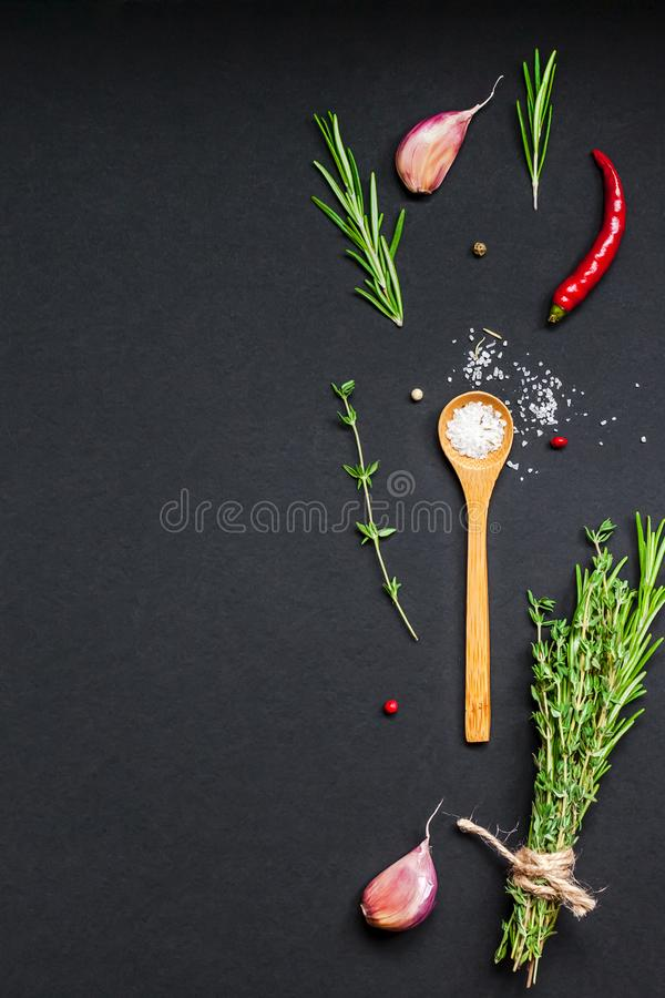 Food background with greens herbs and spices royalty free stock photo