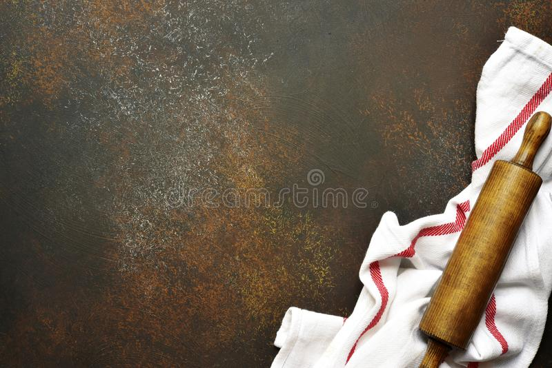Food background with kitchen towel and rolling pin.Top view. royalty free stock photography