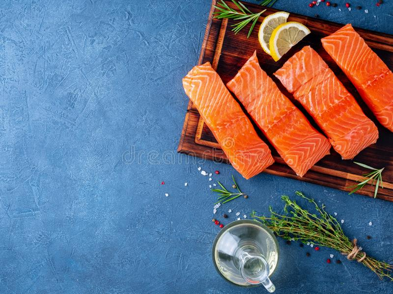Food background, sliced portions large salmon fillet steaks on c royalty free stock images