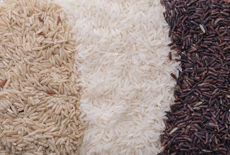 Food background with three rows of rice varieties stock photography