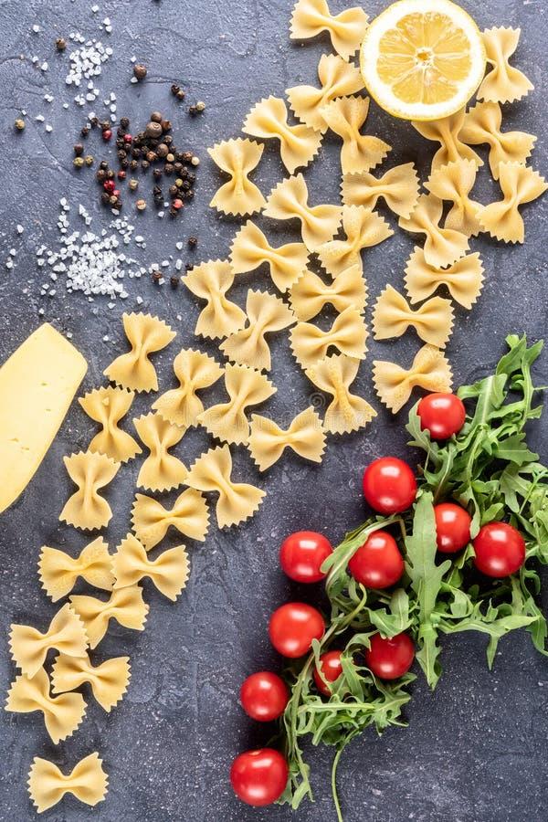 Food background Uncooked Pasta Macaroni Farfalle royalty free stock photos