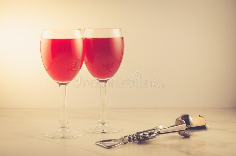 Food background with Wine and corkscrew/Food background with two red Wine and corkscrew. Selective focus royalty free stock images
