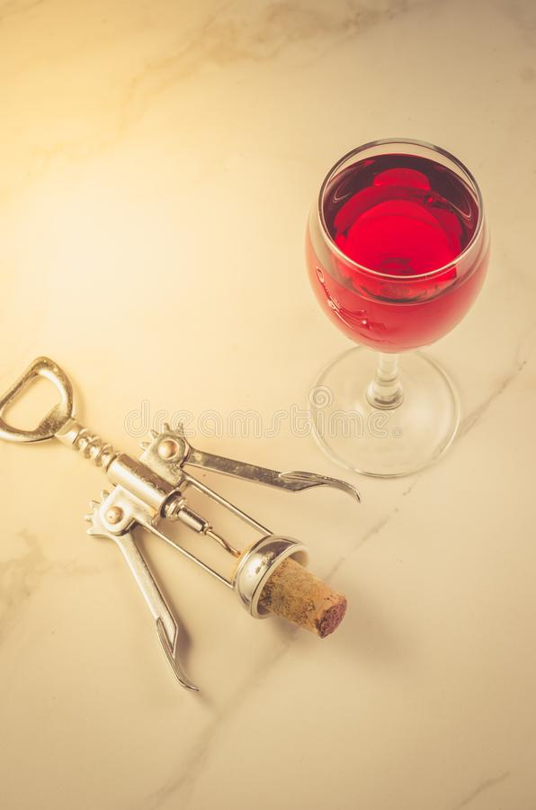 Food background with Wine glass and corkscrew/Food background with red Wine glass and corkscrew. Top view stock image