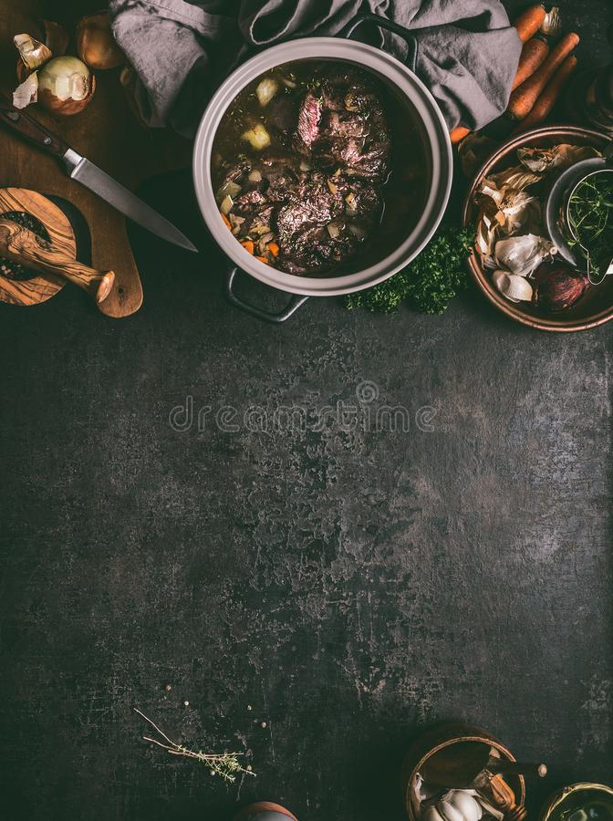Free Food Background With Stewed Beef Meat In Cooking Pot On Dark Table With Herbs, Spices And Kitchen Utensils, Top View, Copy Space. Stock Images - 144815354