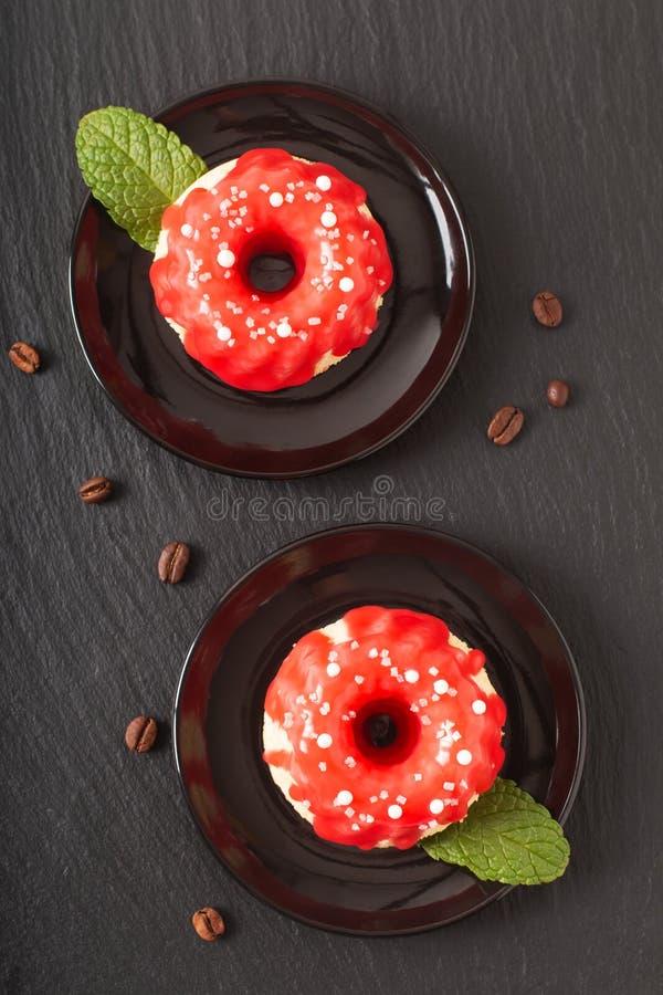 Food bakery concept homemade summer red berry sponge cake on black slate stone plate stock images