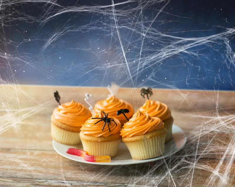 Halloween party cupcakes and jelly candy on table stock photos