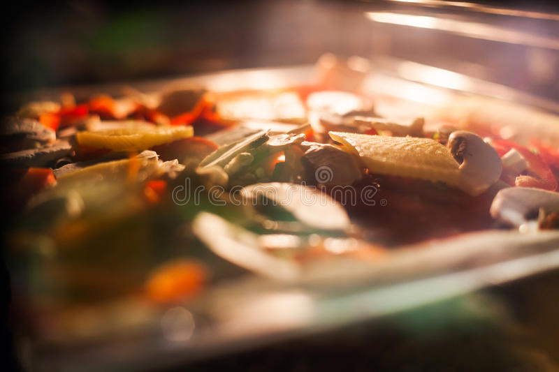 Food baking in oven. Closeup of food baking in oven royalty free stock photos