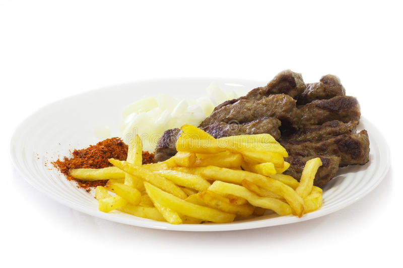 Food of the Balkans. Cevapi - Traditional Food of the Balkans. Minced Meat Cooked on the Barbecue with Fresh Onion stock photo