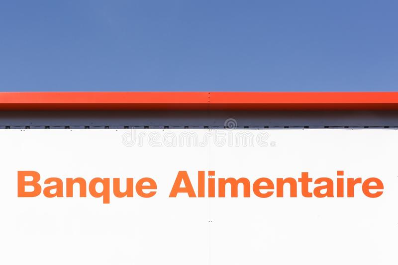 Food bank sign on a wall called banque alimentaire in french stock photography