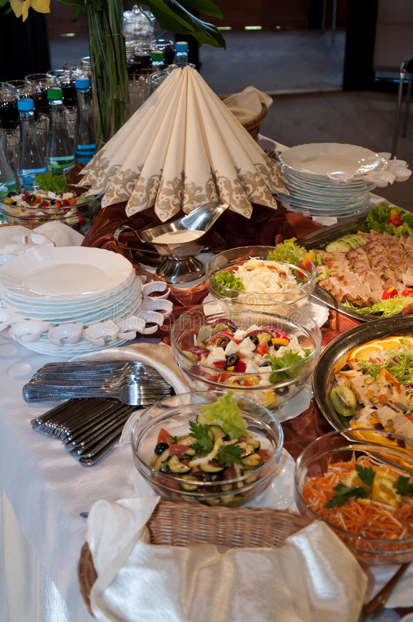 Food on banquet table. Variety of food on banquet table royalty free stock photography