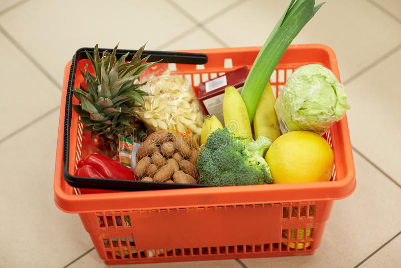 Food basket on grocery or supermarket floor. Sale, shopping and consumerism concept - food basket on grocery or supermarket floor stock image