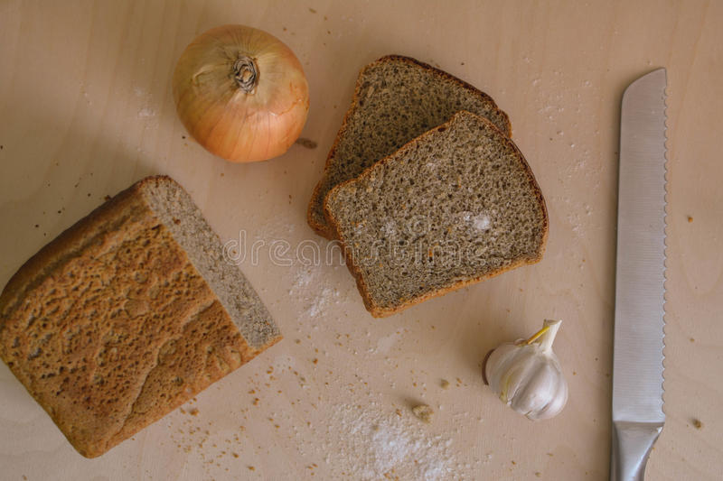 Food. beautiful composition of bread, flour and ears on wooden background royalty free stock image