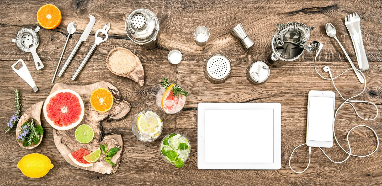 Food blogger desk bar tools accessories electronic devices. Food blogger desk with bar tools, accessories and electronic devices. Flat lay background royalty free stock image