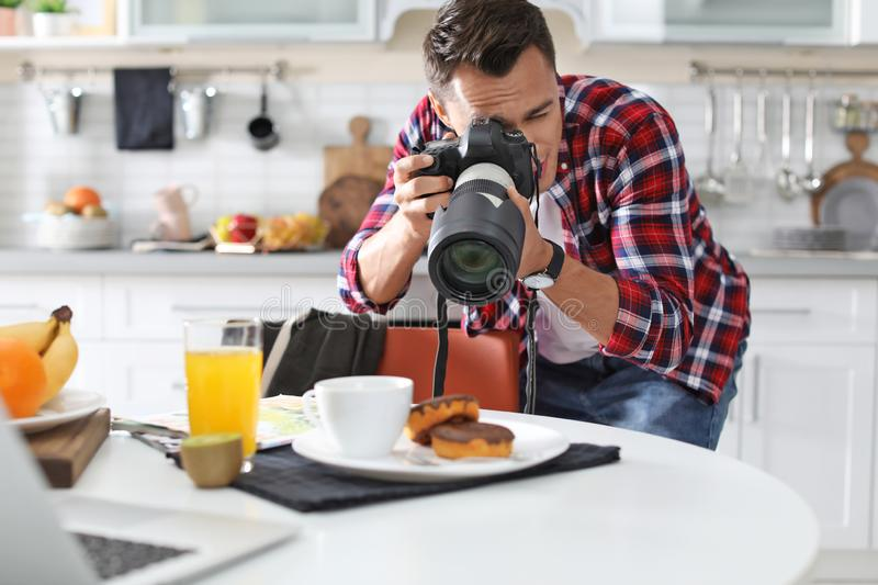 Food blogger taking photo of breakfast. In kitchen stock images