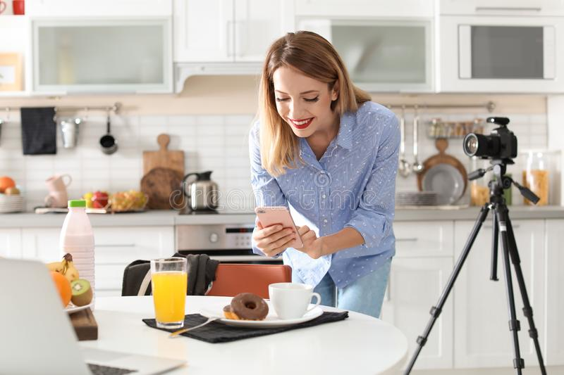 Food blogger taking photo of breakfast. In kitchen royalty free stock photos