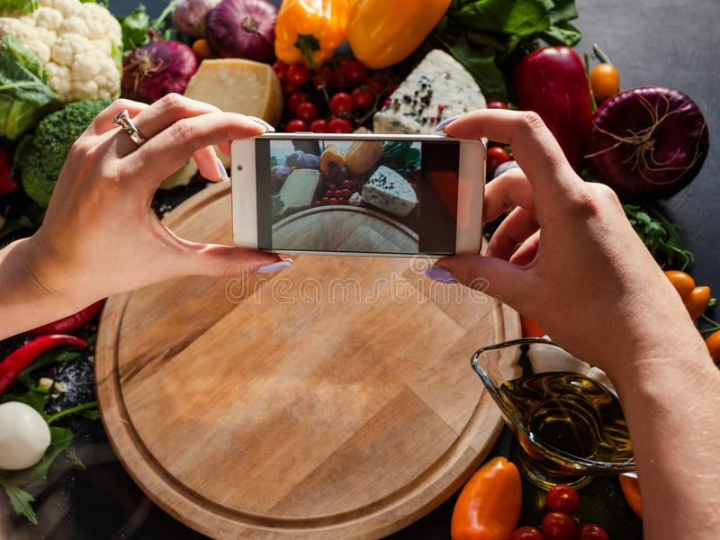 Food blogger taking photo smartphone network royalty free stock photos