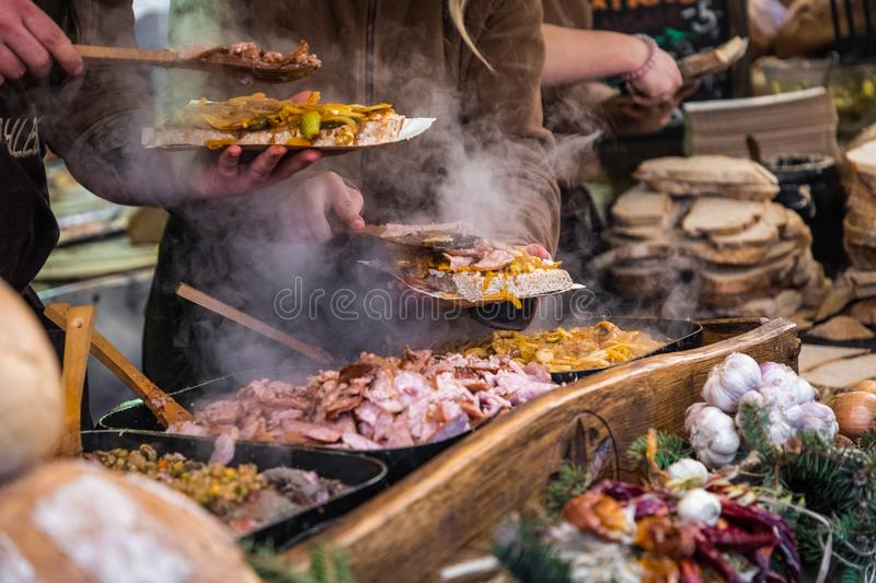 Food booth selling traditional Polish street food in Main Square royalty free stock images