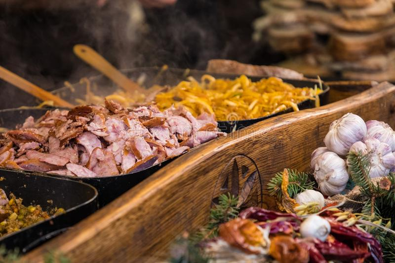 Food booth selling traditional Polish street food in Main Square stock photography