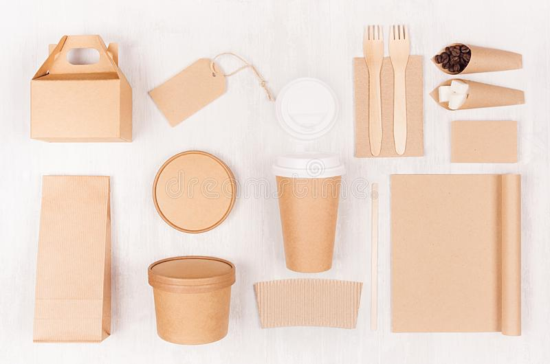 Food branding identity mockup in light modern style - blank coffee cup, packet, box, notebook, label, card of brown paper. Food branding identity mockup in royalty free stock photo
