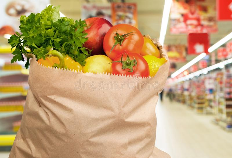 Food in brown grocery bag isolated over royalty free stock images