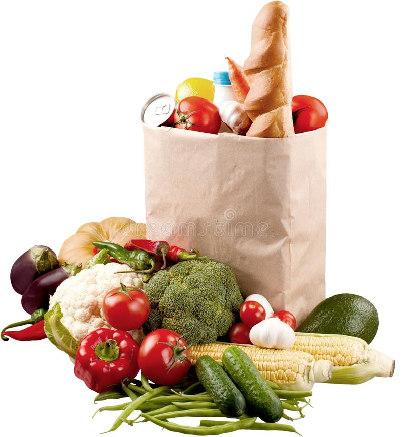 Food in brown grocery bag isolated over white stock photos