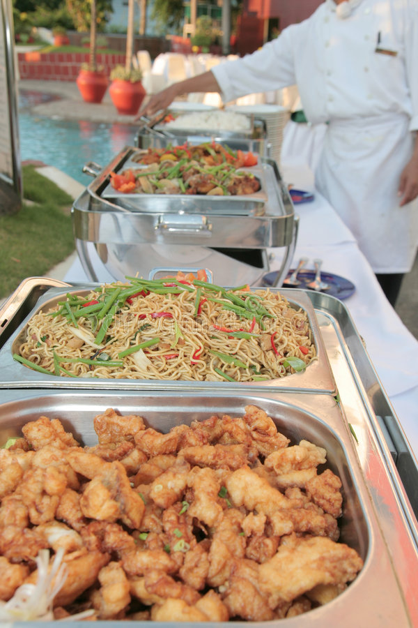 Food at buffet. Food on chaing dish at buffet outdoor royalty free stock photography