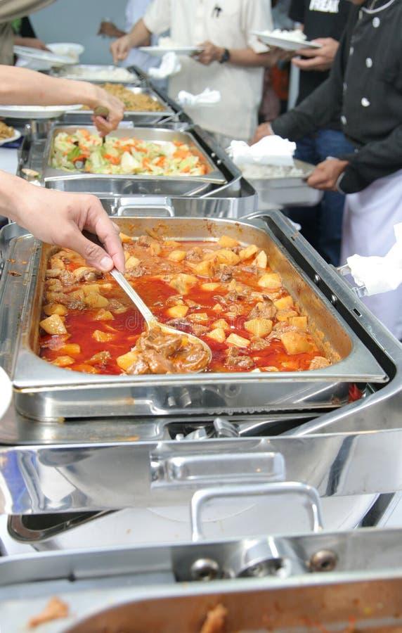 Food at buffet. Food on chafing dish at buffet restaurant stock image
