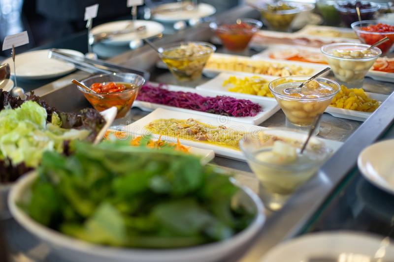 Food on the shelves in the self-service buffet. Food buffet in restaurant royalty free stock image