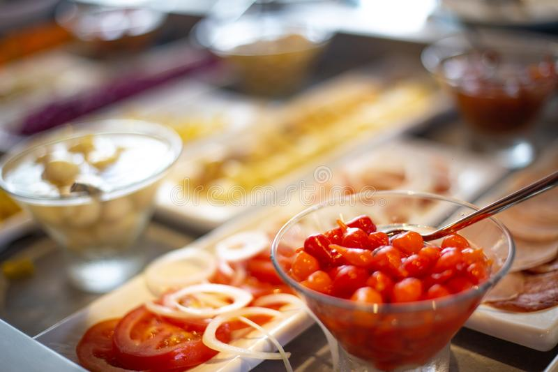 Food on the shelves in the self-service buffet. Food buffet in restaurant stock images