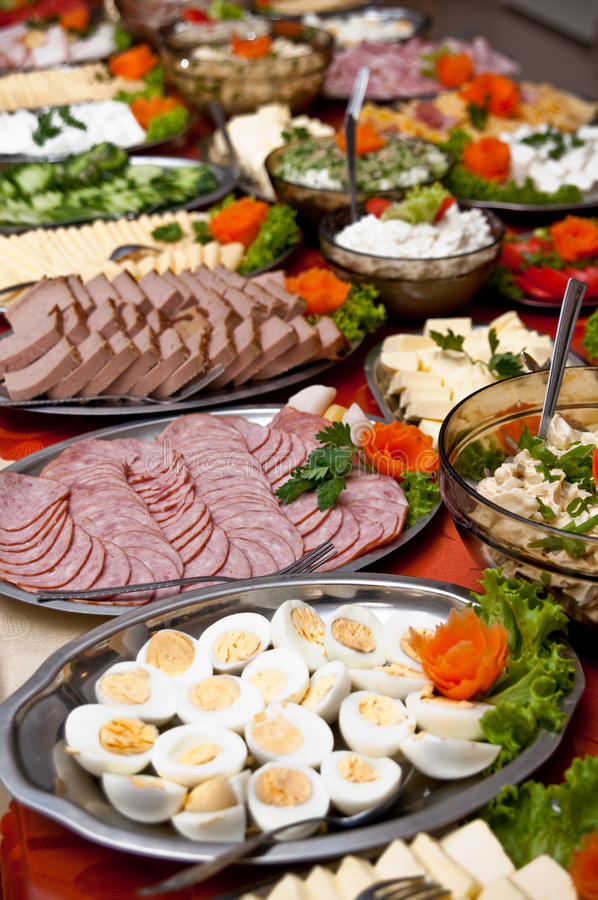 Food on buffet table. Large dishes and platters of food on an extensive food buffet table royalty free stock photography