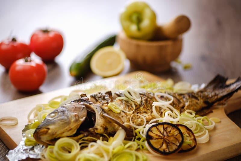 Food carp fish meal roasted. ready whole. Food carp fish meal roasted fried crucian. ready whole royalty free stock image
