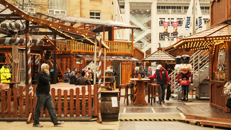 Food chalets in German Market. Bristol, UK - November 9, 2015: the 7th German Christmas Market in Broadmead, Bristol. They are 38 traditional chalets decorated royalty free stock photos