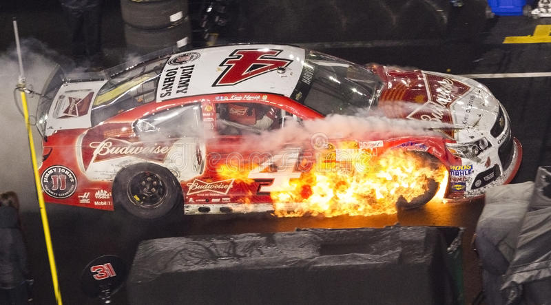 Food City 500. Bristol, TN - Mar 16, 2014: Kevin Harvick (4) pulls in his Budweiser Chevrolet down pit road on fire during the Food City 500 race at Bristol royalty free stock images