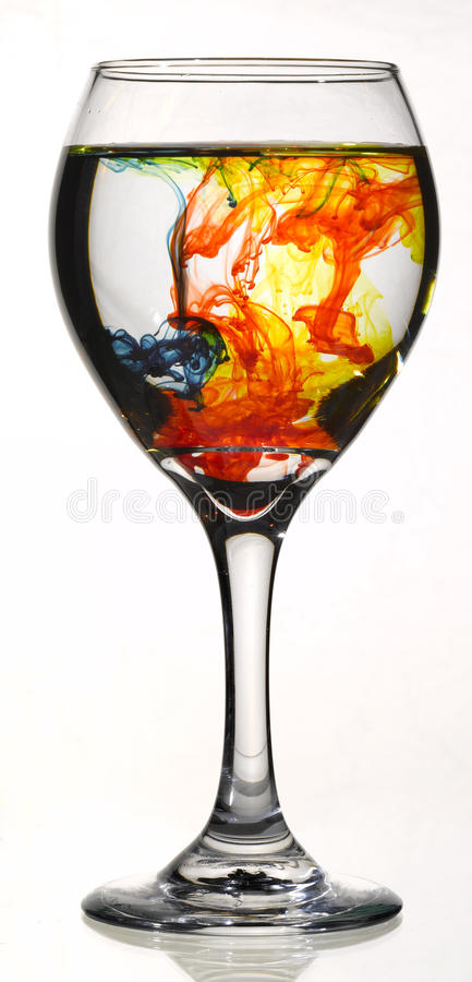 Food Coloring in wine glass stock photo