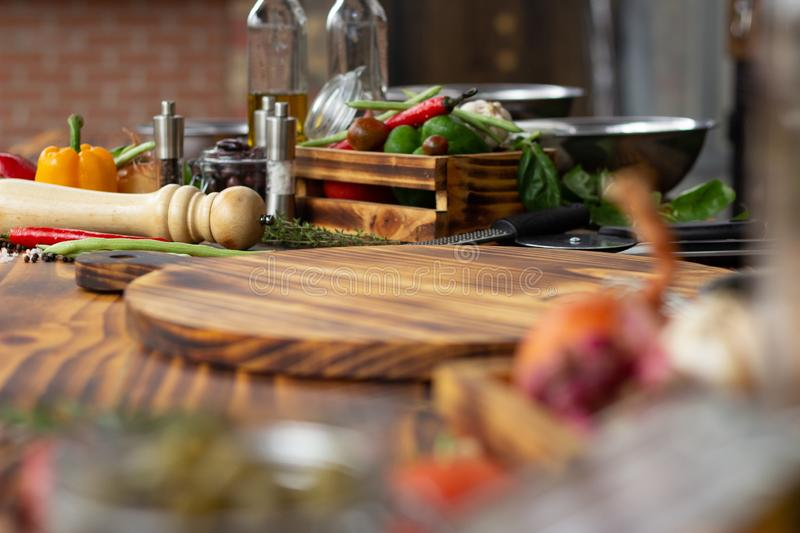 Food composition from fresh vegetables, seasoning and herbs on wooden table. Closeup vegetable and ingredient for stock photo
