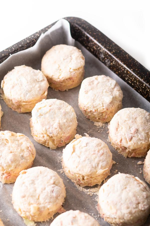 Food concept dough of Homemade buttery, salty Ham and cheese scones before baking on white background royalty free stock photo