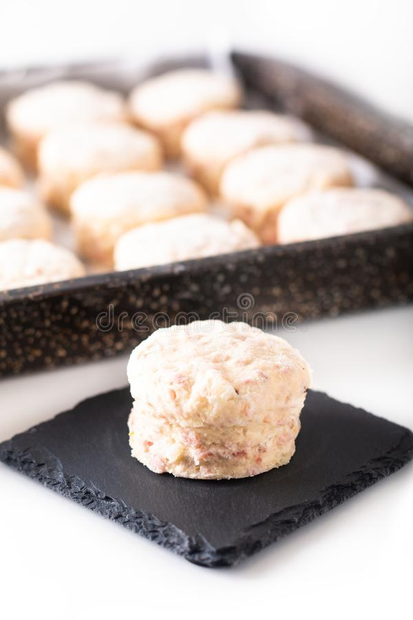 Food concept dough of Homemade buttery, salty Ham and cheese scones before baking on white background stock images
