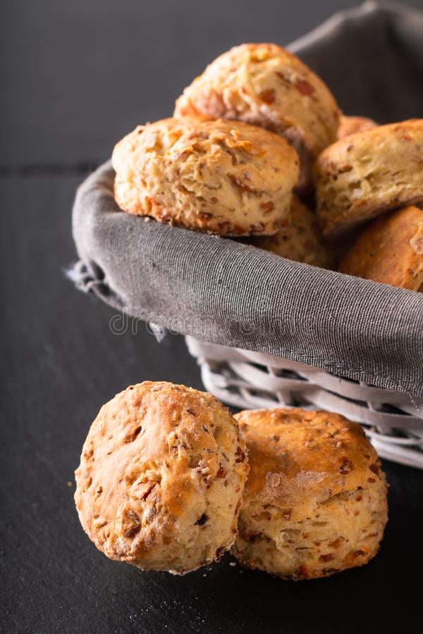 Food concept Fresh baked Homemade buttery, salty Ham and cheese scones on black background stock photography