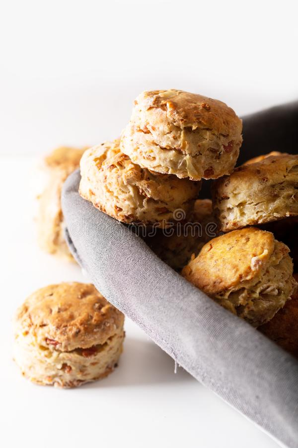 Food concept Fresh baked Homemade buttery, salty Ham and cheese scones on white background stock photography
