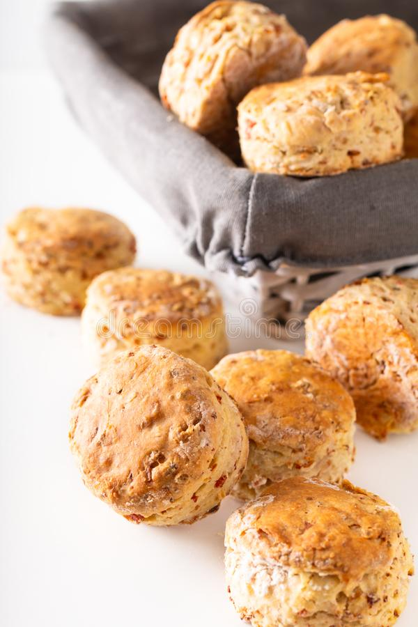 Food concept Fresh baked Homemade buttery, salty Ham and cheese scones on white background royalty free stock photos