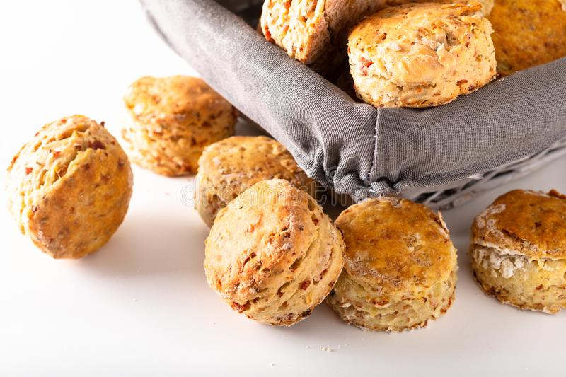 Food concept Fresh baked Homemade buttery, salty Ham and cheese scones on white background royalty free stock photo