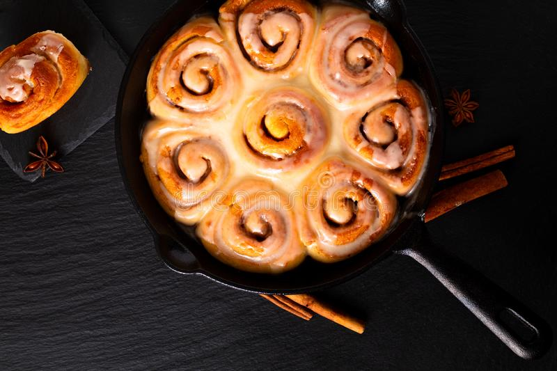 Food concept fresh baked homemade Cinnamon rolls in skillet cast iron pan with copy space royalty free stock photography