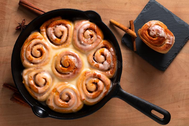 Food concept fresh baked homemade Cinnamon rolls in skillet cast iron pan with copy space stock images