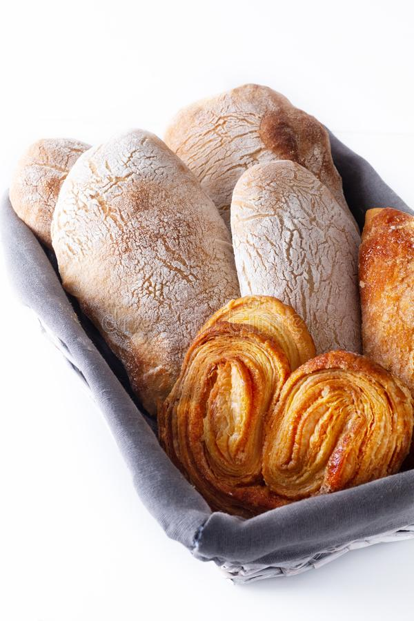 Food concept homemade artisan classic Italian style yeast dough Ciabatta bread and assortment puff pie in bread basket stock images
