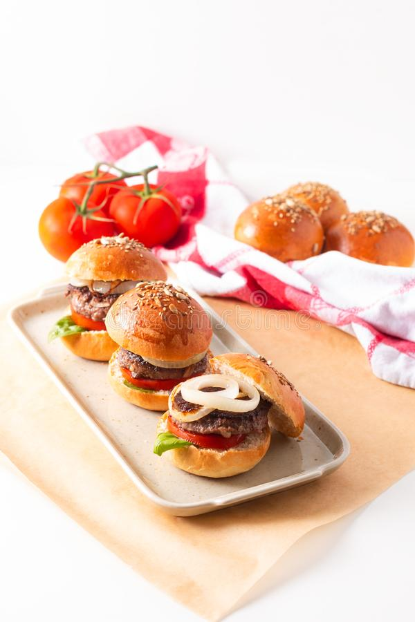 Food concept Homemade beefs hamburgers serve on square plate on white background with copy space stock image