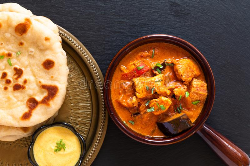 Food concept homemade Tandoori Chicken Masala curry with naan bread and yogurt dipping sauce with copy space stock images