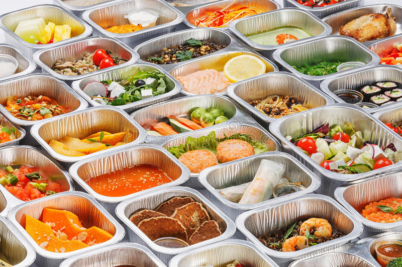 Food in the containers. Separate portions of different food into containers royalty free stock image